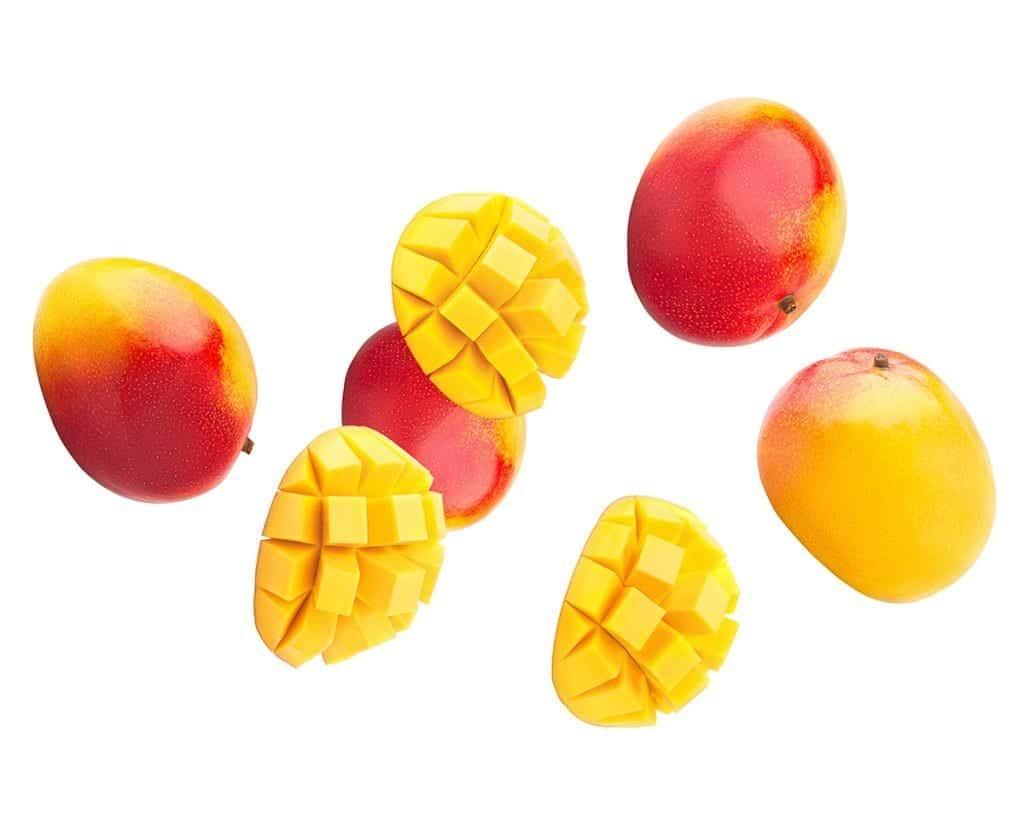 Falling mango on a white background, relating to the terpene myrcene found in CBD.