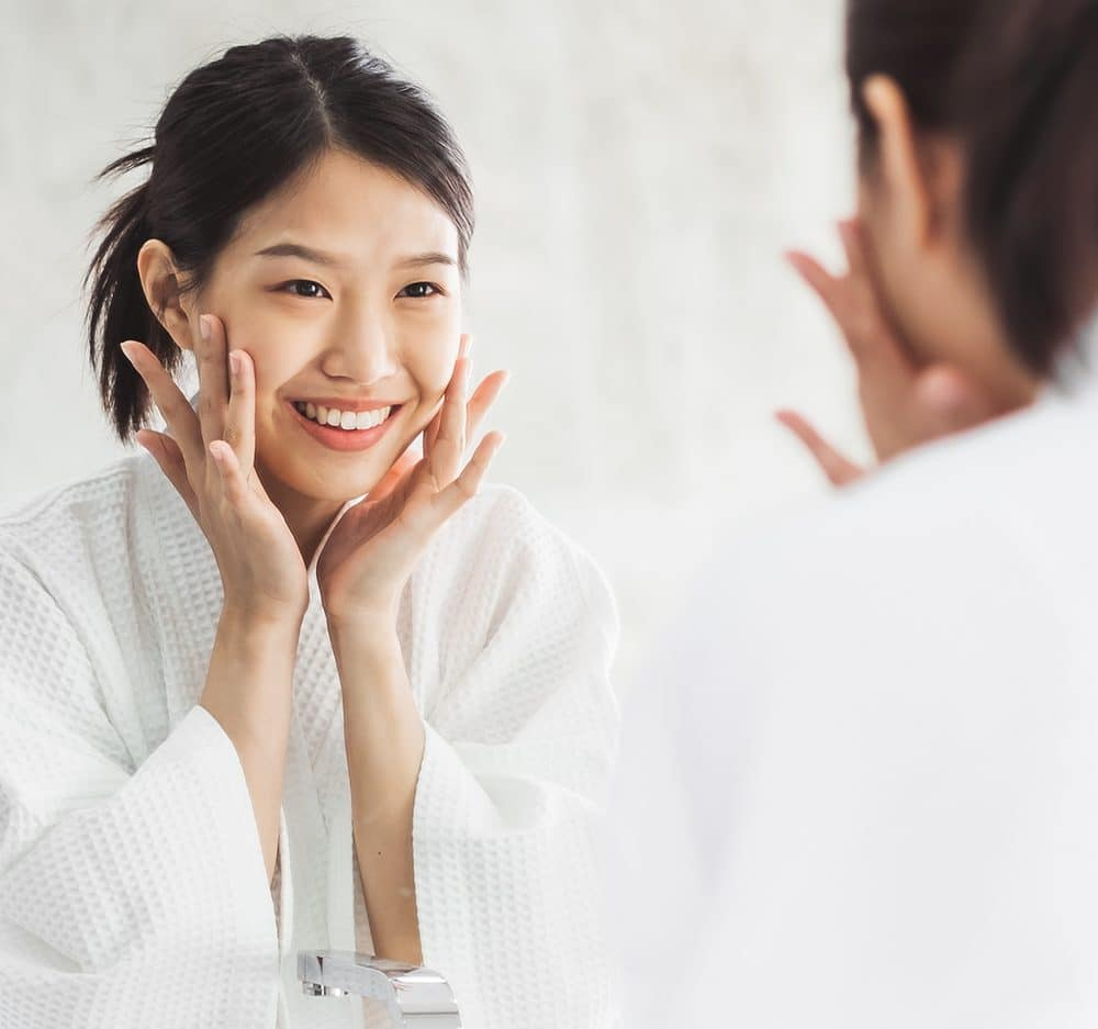 Dragonfly CBD Self Care and your CBD Skincare Routine Woman going through her skincare routine